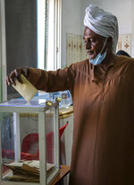 A Djiboutian casts his vote in the presidential election, in the capital Djibouti city, Djibouti Friday, April 9, 2021. The Horn of Africa country of Djibouti is going to the polls on Friday as President Ismail Omar Guelleh seeks a fifth term in the small but strategically important nation home to military bases for the United States, China and others. (AP Photo/Mahad Mohamed)