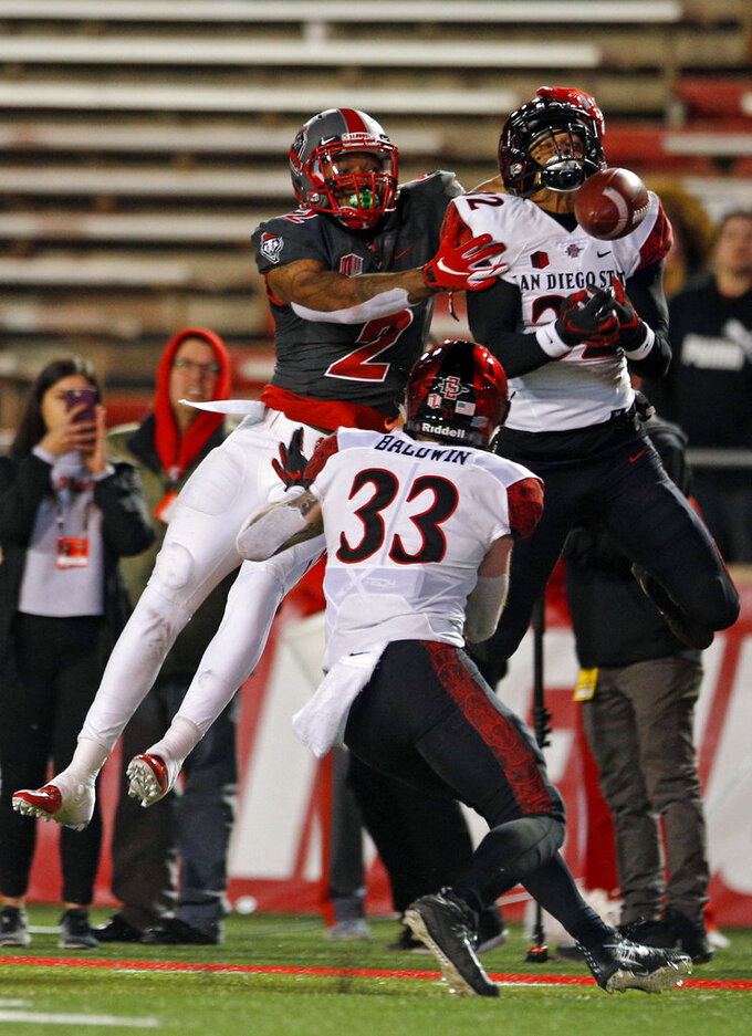San Diego State safety Tayler Hawkins (32) breaks a pass intended for New Mexico wide receiver Delane Hart-Johnson (2) as San Diego State safety Parker Baldwin (33) looks on during the second half of an NCAA college football game in Albuquerque, N.M., Saturday, Nov. 3, 2018. San Diego State won 31-23. (AP Photo/Andres Leighton)
