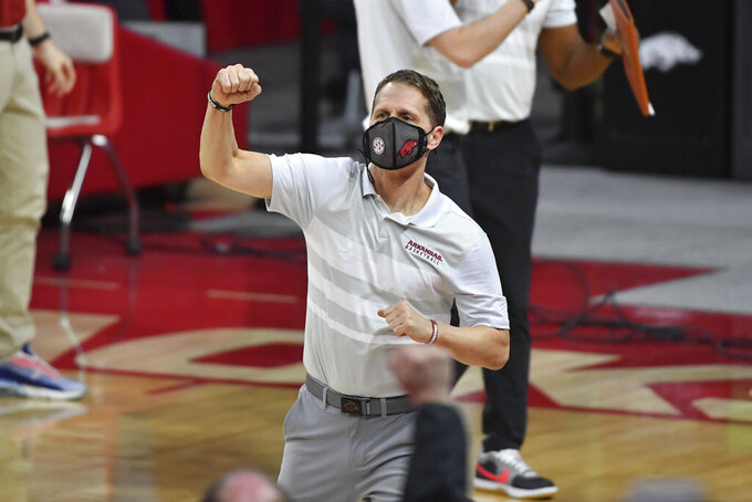 Arkansas coach Eric Musselman celebrates after beating Alabama 81-66 during the second half of an NCAA college basketball game in Fayetteville, Ark. Wednesday, Feb. 24, 2021. (AP Photo/Michael Woods)