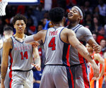 Mississippi guards Breein Tyree (4) and Devontae Shuler, right, bump chests at the end of the team's NCAA college basketball game against Auburn, Wednesday, Jan. 9, 2019 in Oxford, Miss. Mississippi won 82-67. (AP Photo/Rogelio V. Solis)