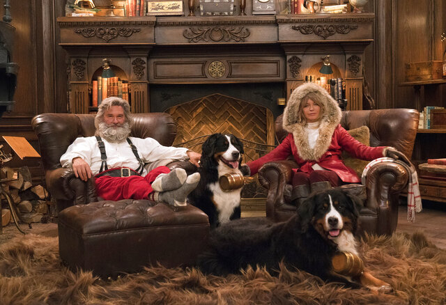 This image released by Netflix shows Kurt Russell, left, and Goldie Hawn from the holiday film