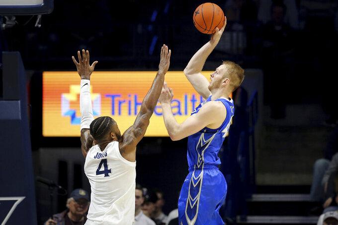 Creighton center Kelvin Jones (43) rises for a shot over Xavier forward Tyrique Jones (4) in the first half of an NCAA college basketball game Saturday, Jan. 11, 2020, in Cincinnati. (Kareem Elgazzar/The Cincinnati Enquirer via AP)