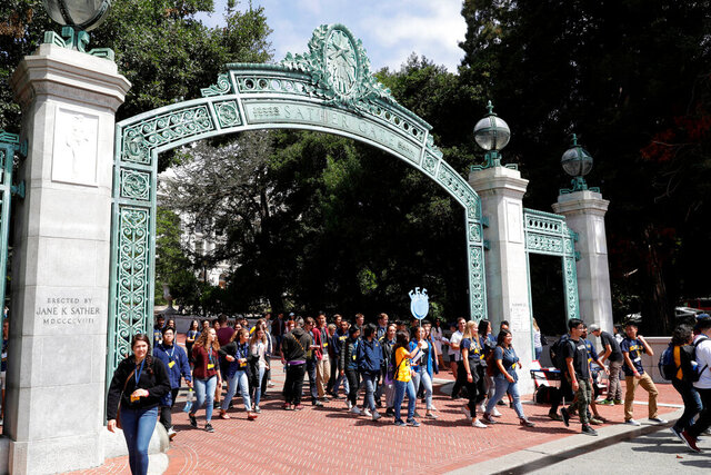 FILE - In this Aug. 15, 2017 file photo, students walk on the University of California, Berkeley campus in Berkeley, Calif. A highly anticipated report from a University of California faculty task force is recommending that the prestigious 10-campus public university system keep the SAT and ACT tests as part of its admissions process, a blow to activist groups that argued the tests hurt low-income and other disadvantaged students. (AP Photo/Marcio Jose Sanchez, File)