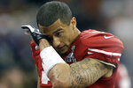 FILE - In this Feb. 3, 2013, file photo, San Francisco 49ers quarterback Colin Kaepernick (7) wipes his face after losing 34-31 to the Baltimore Ravens in the NFL Super Bowl XLVII football game, in New Orleans. Kaepernick nearly orchestrated a miracle comeback. (AP Photo/David Goldman, File)
