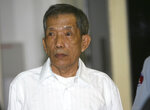 FILE - In this March 30, 2020, file photo, former Khmer Rouge prison chief Kaing Guek Eav, also know as Duch, looks on during the first day of a U.N.-backed tribunal in Phnom Penh, Cambodia. The Khmer Rouge's chief jailer, who admitted overseeing the torture and killings of as many as 16,000 Cambodians while running the regime's most notorious prison, died at a hospital in Cambodia early Wednesday morning, Sept. 2, 2020. Kaing Guek Eav, known as Duch, was 77 and had been serving a life prison term for war crimes and crimes against humanity. (Mak Remissa/Pool Photo via AP, File)