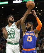 Boston Celtics forward Semi Ojeleye (37) knocks the ball away from New York Knicks forward Marcus Morris Sr. (13) during the first quarter of an NBA basketball game Friday, Nov. 1, 2019, in Boston. (AP Photo/Elise Amendola)