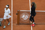 Serena Williams of the U.S. walks to her bench after defeating Kristie Ahn of the U.S., left, in the first round match of the French Open tennis tournament at the Roland Garros stadium in Paris, France, Monday, Sept. 28, 2020. (AP Photo/Alessandra Tarantino)