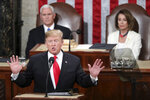 In this Feb. 5, 2019 photo, President Donald Trump delivers his State of the Union address to a joint session of Congress on Capitol Hill in Washington, as Vice President Mike Pence and Speaker of the House Nancy Pelosi, D-Calif., watch. In his State of the Union, President Donald Trump said a