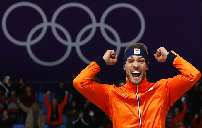 Gold medallist Kjeld Nuis of The Netherlands celebrates on the podium after the men's 1,500 meters speedskating race at the Gangneung Oval at the 2018 Winter Olympics in Gangneung, South Korea, Tuesday, Feb. 13, 2018. (AP Photo/John Locher)
