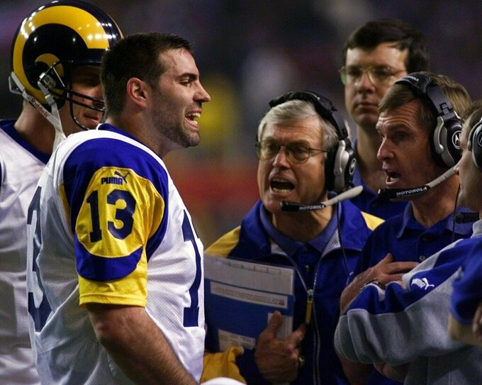 File-This Jan. 30, 2000, file photo shows St. Louis Rams quarterback Kurt Warner talking to Rams head coach Dick Vermeil, at center, and other coaches during a St. Louis Rams timeout in the second quarter in Super Bowl XXXIV in Atlanta. The Greatest Show On Turf. Yes, at the turn of the century, there was a group that shared so many light-em-up traits with these Rams and Patriots. The St. Louis Rams under of all people,  Vermeil, for decades a defense-minded coach,  employed a quick-strike scheme with a resourceful quarterback, game-breaking receivers, a Hall of Fame running back  and an offensive line that could dominate while blocking in the ground game or protecting the passer. (AP Photo/Susan Walsh, File)