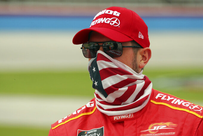 NASCAR Xfinity Series driver Michael Annett (1) stands on pit road before a NASCAR Xfinity Series auto race at Texas Motor Speedway in Fort Worth, Texas, Saturday Oct. 24, 2020. (AP Photo/Richard W. Rodriguez)