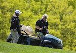 John Daly gets into a golf cart after teeing off on the fifth hole during a practice round for the PGA Championship golf tournament, Wednesday, May 15, 2019, at Bethpage Black in Farmingdale, N.Y. (AP Photo/Seth Wenig)