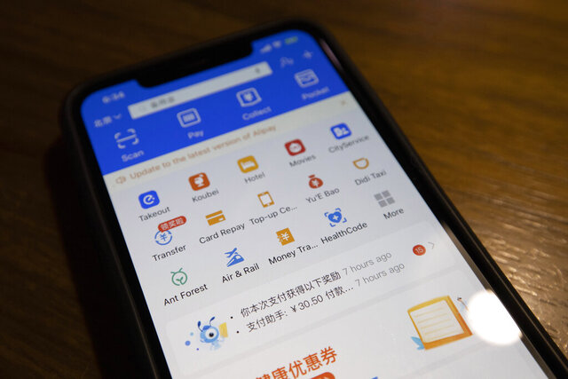 The app for Alipay, the mobile payments service operated by Ant Group, is seen on a smartphone in Beijing on Monday, July 20, 2020. Ant Group, the online payments arm of e-commerce giant Alibaba Group, announced plans Monday for an initial public stock offering that could become the world's biggest since the start of the coronavirus pandemic. (AP Photo/Ng Han Guan)