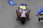 Worknesh Degefa, of Ethiopia, kisses the ground after winning the women's division of the 123rd Boston Marathon on Monday, April 15, 2019, in Boston. (AP Photo/Charles Krupa)