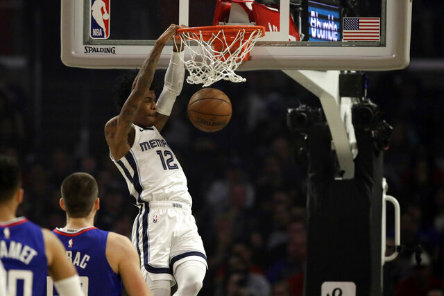 Memphis Grizzlies' Ja Morant (12) dunks against the Los Angeles Clippers during the first half of an NBA basketball game Saturday, Jan. 4, 2020, in Los Angeles. (AP Photo/Marcio Jose Sanchez)