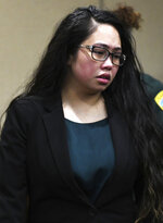 Katherine Magbanua enters the courtroom on Friday, Oct. 11, 2019, in Tallahassee, Fla., to hear the jury's verdict in her case. Jurors could not reach a unanimous decision, and a mistrial was declared. Prosecutors plan to retry her in the 2014 murder of Dan Markel.(Alicia Devine/Tallahassee Democrat via AP)