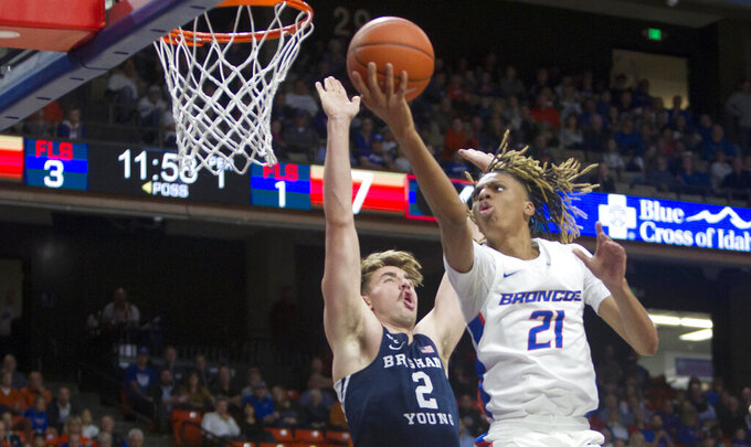 Boise State guard Derrick Alston scores on a drive and fouled by BYU guard Zac Seljaas in the first half of an NCAA college basketball game Wednesday, Nov. 20, 2019, in Boise. (Darin Oswald/Idaho Statesman via AP)