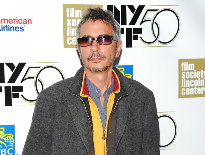 """FILE - Director Leos Carax attends the premiere of """"Holy Motors"""" during the 2012 New York Film Festival in New York on Oct. 11, 2012. Carax's """"Annette,"""" starring Marion Cotillard and Adam Driver, will open the 74th Cannes Film Festival on July 6, festival organizers said Monday. """"Annette"""" is Carax's first English-language film and the French director's anticipated follow-up to his celebrated, surreal 2012 film """"Holy Motors."""" (Photo by Evan Agostini/Invision/AP, File)"""