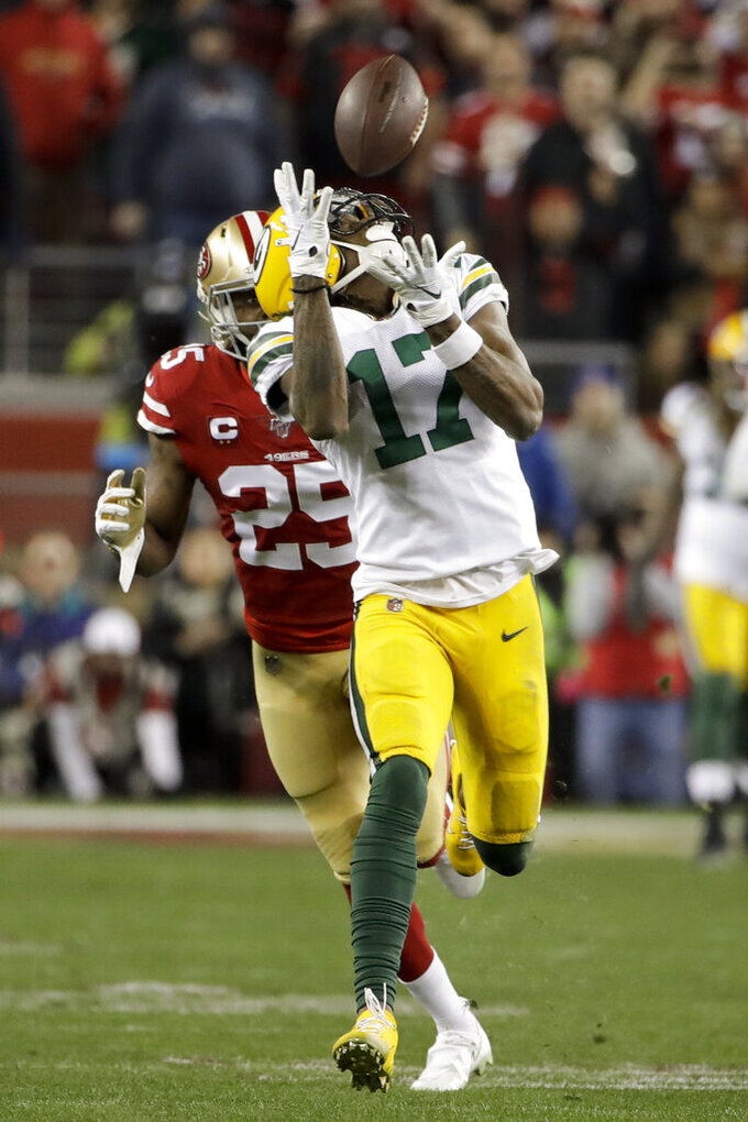Green Bay Packers wide receiver Davante Adams catches a pass in front of San Francisco 49ers cornerback Richard Sherman during the second half of the NFL NFC Championship football game Sunday, Jan. 19, 2020, in Santa Clara, Calif. (AP Photo/Marcio Jose Sanchez)