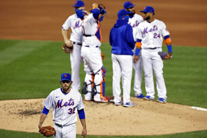 New York Mets pitcher Steven Matz walks to the dugout after being relieved during the third inning of a baseball game against the Atlanta Braves, Friday, Sept. 18, 2020, in New York. (AP Photo/Adam Hunger)