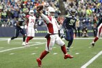 In this Dec. 22, 2019, photo, Arizona Cardinals quarterback Kyler Murray passes against the Seattle Seahawks during the first half of an NFL football game in Seattle. Murray's impressive first season is early proof that the Arizona Cardinals made a good decision when they selected the quarterback with the No. 1 overall pick in April. (AP Photo/Elaine Thompson)