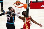 Atlanta Hawks forward Solomon Hill (18) goes to the basket as Memphis Grizzlies center Jonas Valanciunas (17) defends in the first half of an NBA basketball game Wednesday, April 7, 2021, in Atlanta. (AP Photo/John Bazemore)