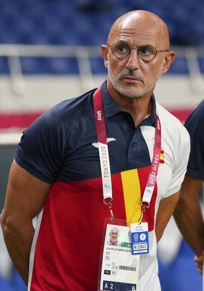 Spain's coach Luis de la Fuente gestures prior a men's soccer match against Argentina at the 2020 Summer Olympics, Wednesday, July 28, 2021, in Saitama, Japan. (AP Photo/Martin Mejia)