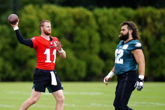 Philadelphia Eagles' Carson Wentz, left, participates in a drill with Jason Kelce during practice at the NFL football team's facility, Thursday, Sept. 10, 2020, in Philadelphia. (AP Photo/Matt Slocum)