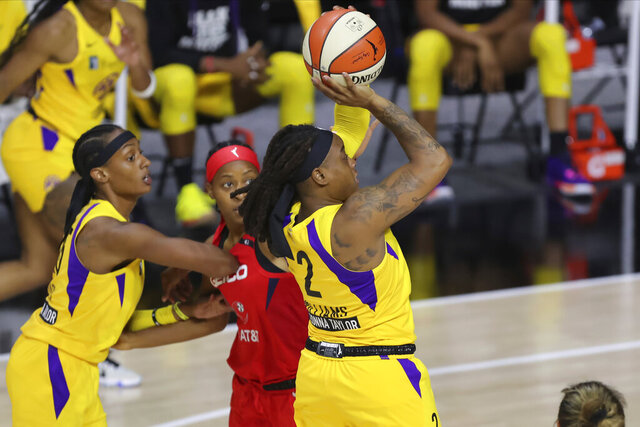 Los Angeles Sparks' Riquna Williams shoots against the Washington Mystics during the first half of a WNBA basketball game Thursday, Aug. 13, 2020, in Bradenton, Fla. (AP Photo/Mike Carlson)