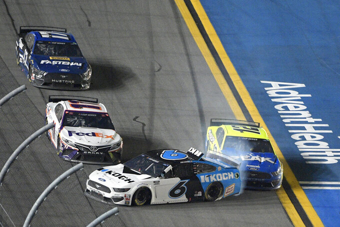 Ryan Newman (6) gets turned into the wall by Ryan Blaney (12) as Denny Hamlin (11) misses them along the front stretch to win the NASCAR Daytona 500 auto race at Daytona International Speedway, Monday, Feb. 17, 2020, in Daytona Beach, Fla. (AP Photo/Phelan M. Ebenhack)