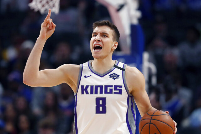 Sacramento Kings guard Bogdan Bogdanovic brings the ball up court during the second half of an NBA basketball game, Wednesday, Jan. 22, 2020, in Detroit. After making a big splash in free agency, the Atlanta Hawks are eager to see how all their newcomers fit in with their core of young players. Especially Bogdan Bogdanovic and Danilo Gallinari. (AP Photo/Carlos Osorio)
