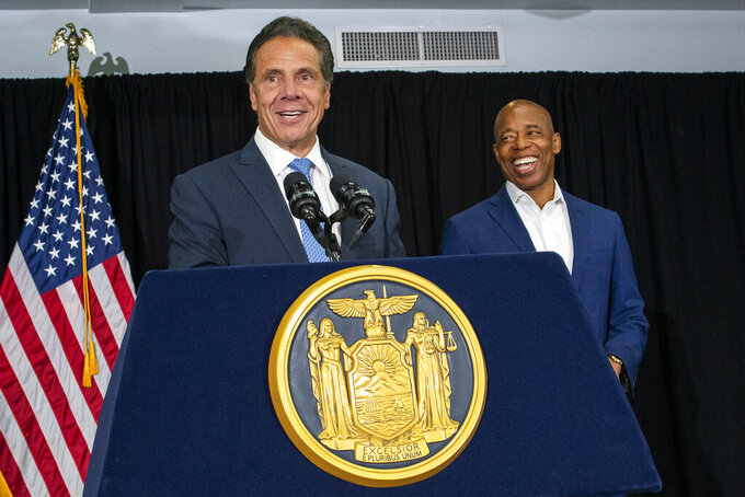 New York Gov. Andrew Cuomo, left, and Brooklyn Borough President and New York City mayoral candidate Eric Adams smile during a press conference at Lenox Road Baptist Church on Wednesday, July 14, 2021, in Brooklyn, NY. (AP Photo/Eduardo Munoz Alvarez)