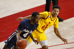 Jackson State guard Tristan Jarrett, left, drives the ball around Iowa State guard Rasir Bolton during the first half of an NCAA college basketball game, Sunday, Dec. 20, 2020, in Ames, Iowa. (AP Photo/Matthew Putney)