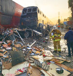 This photo provided by the Norwalk Sheriff's Station shows first responders at the scene after an RV was hit by a commuter train and burst into flames along a track in Santa Fe Springs, Calif., Friday, Nov. 22, 2019. Authorities say the collision occurred shortly after 5:30 a.m. Friday at an intersection in an industrial area of Santa Fe Springs. There were no immediate reports of injuries. All passengers on the Metrolink train were safely evacuated. (Norwalk Sheriff's Station via AP)
