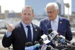 U.S. Rep. Josh Gottheimer (NJ-5), left, and and Rep. Bill Pascrell (NJ-9) stand at a podium during a news conference near the George Washington Bridge talking about the congressmen's plan to fight back against New York City's proposed congestion tax on New Jersey commuters, Wednesday, April 17, 2019, in Fort Lee, N.J. The congressmen announced legislation they say will ensure New Jersey motorists, who already pay up to $15 for bridge or tunnel tolls, won't be charged twice. New York's legislature approved a conceptual plan this month. that will allocate revenue to fix the city's mass transit system. New York would become the first American city to use so-called congestion pricing to reduce gridlock and fund mass transit improvements. (AP Photo/Julio Cortez)