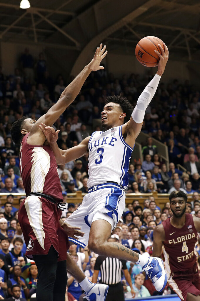 Duke guard Tre Jones (3) drves to the basket against Florida State guard Trent Forrest during the second half of an NCAA college basketball game in Durham, N.C., Monday, Feb. 10, 2020. (AP Photo/Gerry Broome)