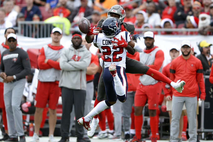 Houston Texans cornerback Gareon Conley (22) breaks up a pass intended for Tampa Bay Buccaneers wide receiver Breshad Perriman (19) during the first half of an NFL football game Saturday, Dec. 21, 2019, in Tampa, Fla. (AP Photo/Jason Behnken)