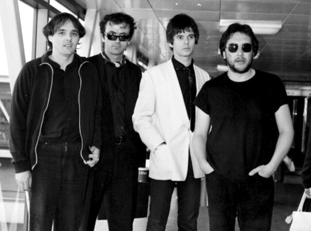 FILE - In this July 6, 1980 file photo, from left, Dave Greenfield, Hugh Cornwell, Jean-Jacques Burnel and Jet Black of the group The Stranglers pose for a photo. Dave Greenfield, the keyboard player with British punk band The Stranglers and who penned the music to their biggest hit Golden Brown, has died after testing positive for coronavirus. He was 71. The band's official website announced that Greenfield died on Sunday, May 3, 2020 after contracting the virus following a stay in hospital for heart problems. (PA via AP, File)