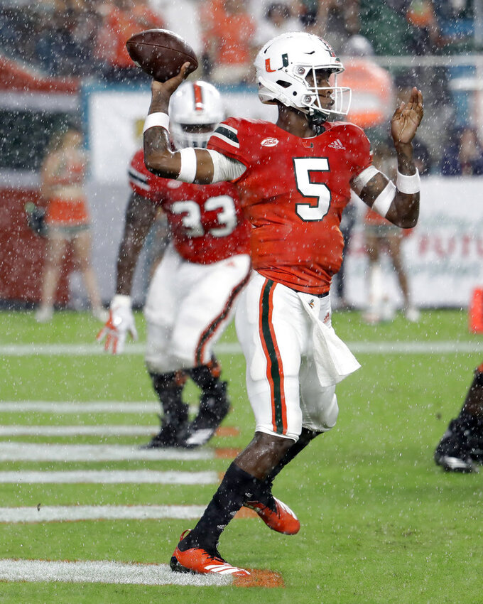 Miami quarterback N'Kosi Perry (5) throws a pass during the first half of an NCAA college football game against Duke, Saturday, Nov. 3, 2018, in Miami Gardens, Fla. (AP Photo/Lynne Sladky)