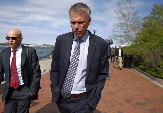 FILE - In this May 22, 2019 file photo, Peter Jan Sartorio leaves federal court in Boston after pleading guilty to charges in a nationwide college admissions bribery scandal. Sartorio was sentenced on Friday, Oct. 11, to one year of probation. (AP Photo/Michael Dwyer, File)