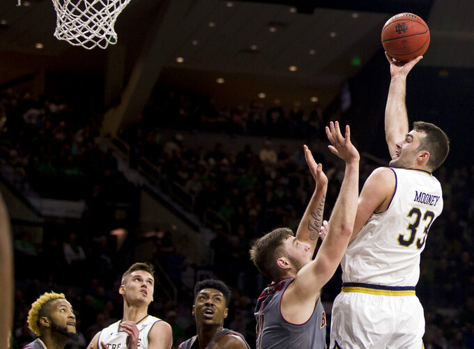 Notre Dame's John Mooney (33) goes up for a shot over Boston College's Nik Popovic during the second half of an NCAA college basketball game Saturday, Jan. 12, 2019, in South Bend, Ind. Notre Dame won 69-66. (AP Photo/Robert Franklin)