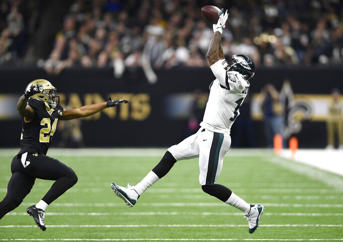 Philadelphia Eagles wide receiver Alshon Jeffery (17) pulls in a reception against New Orleans Saints strong safety Vonn Bell (24) in the first half of an NFL divisional playoff football game in New Orleans, Sunday, Jan. 13, 2019. (AP Photo/Bill Feig)