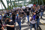 Thousands walk over the Ferry Street Bridge in Eugene, Ore., during a Black Lives Matter March on Sunday, May 31, 2020, about the deaths of George Floyd and others. (Chris Pietsch/The Register-Guard via AP)