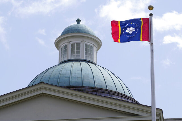 The magnolia flower centered banner chosen Wednesday, Sept. 2, 2020 by the Mississippi State Flag Commission flies outside the Old State Capitol Museum in downtown Jackson, Miss. The nine member committee voted to recommend a design with the state flower, now known as the