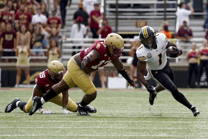 Missouri running back Tyler Badie (1) rushes with the ball past Boston College defensive lineman Khris Banks (13) during the first half of an NCAA college football game, Saturday, Sept. 25, 2021, in Boston. (AP Photo/Mary Schwalm)