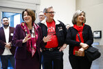 Democratic presidential candidate Sen. Amy Klobuchar, D-Minn., left, tours the Culinary Health Center with Culinary Union president Ted Pappageorge, center, and secretary-treasurer Geoconda Arguello-Kline, Friday, Feb. 14, 2020, in Las Vegas. (AP Photo/Patrick Semansky)
