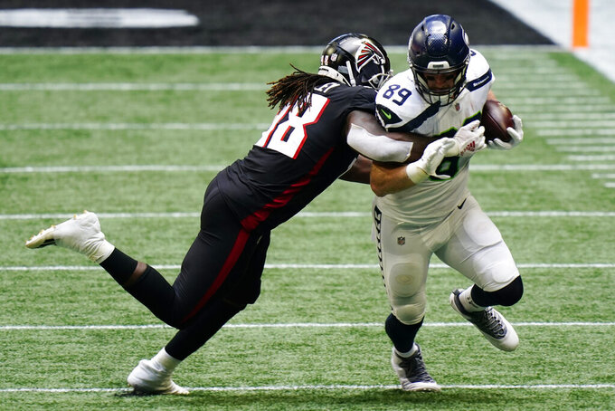 Atlanta Falcons defensive end Takkarist McKinley (98) hits Seattle Seahawks tight end Will Dissly (89) during the second half of an NFL football game, Sunday, Sept. 13, 2020, in Atlanta. (AP Photo/Brynn Anderson)