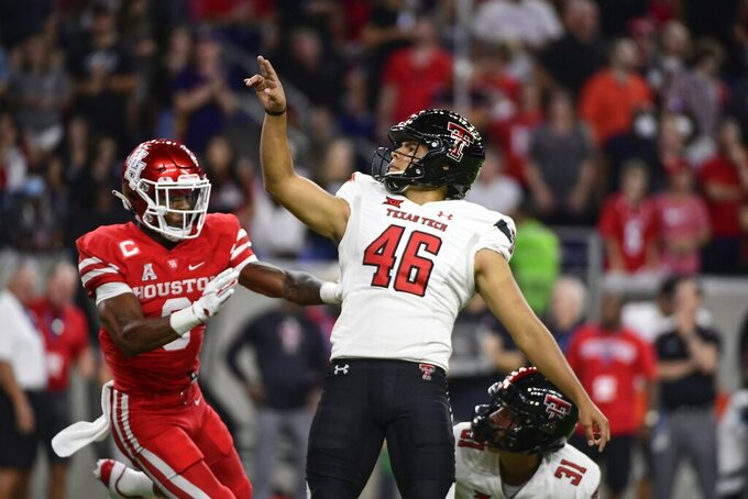 Texas Tech place kicker Jonathan Garibay (46) kicks an extra point against Houston during the second half of an NCAA college football game Saturday, Sept. 4, 2021, in Houston. (AP Photo/Justin Rex)