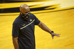 Missouri coach Cuonzo Martin talks to players on the bench during the first half of the team's NCAA college basketball game against Oral Roberts on Wednesday, Nov. 25, 2020, in Columbia, Mo. (AP Photo/L.G. Patterson)
