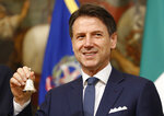 Italy's Prime Minister Giuseppe Conte, rings the bell that traditionally opens the meeting of the cabinet at Chigi Palace in Rome, Thursday, Sept. 5, 2019. Italian Premier Giuseppe Conte forged a new coalition government Wednesday that teams up the populist 5-Star Movement and center-left Democrats in an unusual alliance of rivals to banish for now the specter of early election that likely could have seen the triumph of Italy's fast-rising right-wing forces. (AP Photo/Domenico Stinellis)